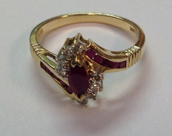 Vintage Marquise Ruby And Diamond Ring in 14k Yellow Gold