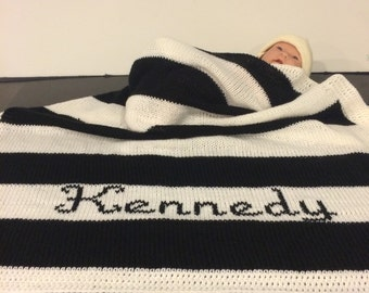 Knitted black and white stripe baby blanket with white crochet border. Baby's first name monogrammed for free. Free shipping in the USA