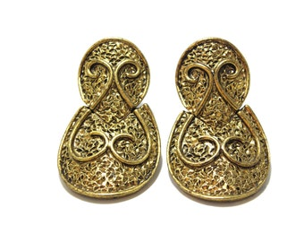 Golden earclips with ornaments