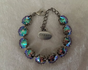 Crystal bracelet, 12mm swarovski crystal bracelet, hues of purple, green, and pink. Paradise -affordable jewelry, great gift, support cancer