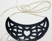 Black leather necklace, with hand carved pendant and crochet strips.