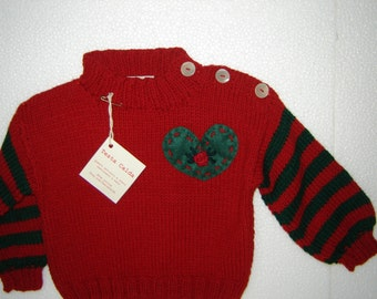 Jersey in pure red wool and verdone with a cooked wool heart for children of 12/18 months