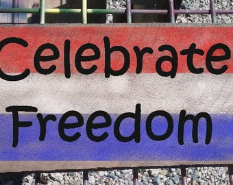 The Celebrate Freedom sign in patriotic colors, hand crafted from reclaimed Michigan lumber (PT010)