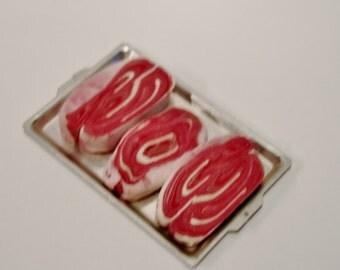 Meat cuts on trays: steaks