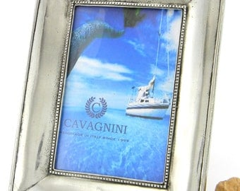 pewter picture frame. Brilliant finish. Dim. 19 x 24 cm