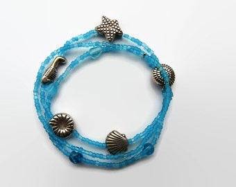 "seed bead bracelet turquoise, friendship bracelet. Set of 3. Stretch , charms, ""sea theme"" charms, bigger blue glass beads. Bali beads"