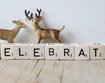 Vintage Letter Cubes spell out the word CELEBRATE.