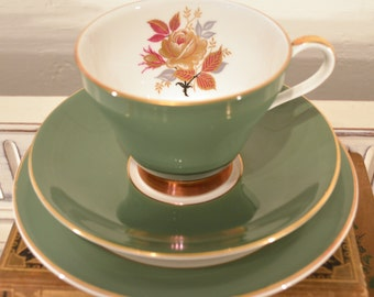 green royal grafton china trio with floral details and gilding
