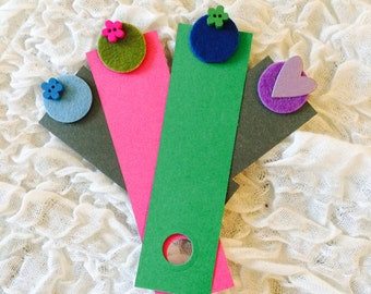 Cardboard and felt bookmarks with cardboard and wood decorations
