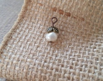 "Pearl ""cotton boll""charm with leaf bead cap."