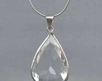 Sterling silver wrapped crystal pendant