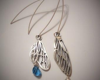 Handmade Sterling silver asymmetrical wing earrings with blue topaz