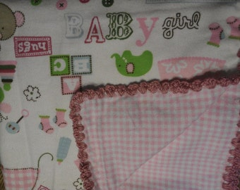 Reversible white and pink patterned baby girls flannel blanket with pink crochet edges