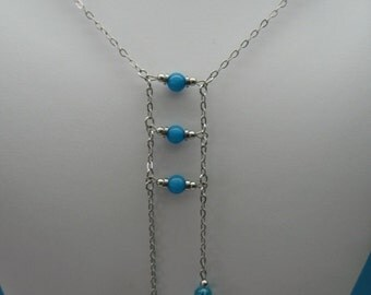 Long necklace natural stone and glass. 100% stainless steel.