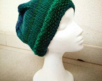 Handknitted beanie. Green-blue shades.