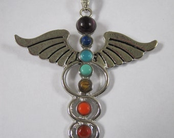 "Multi-stone Caduceus (Rod of Hermes) Chakra necklace.   Nice selection of real stones set in silver includes free 18"" 925 silver chain."