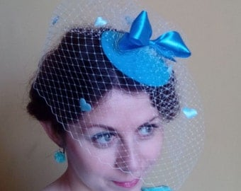 Blue hat with a veil and hearts