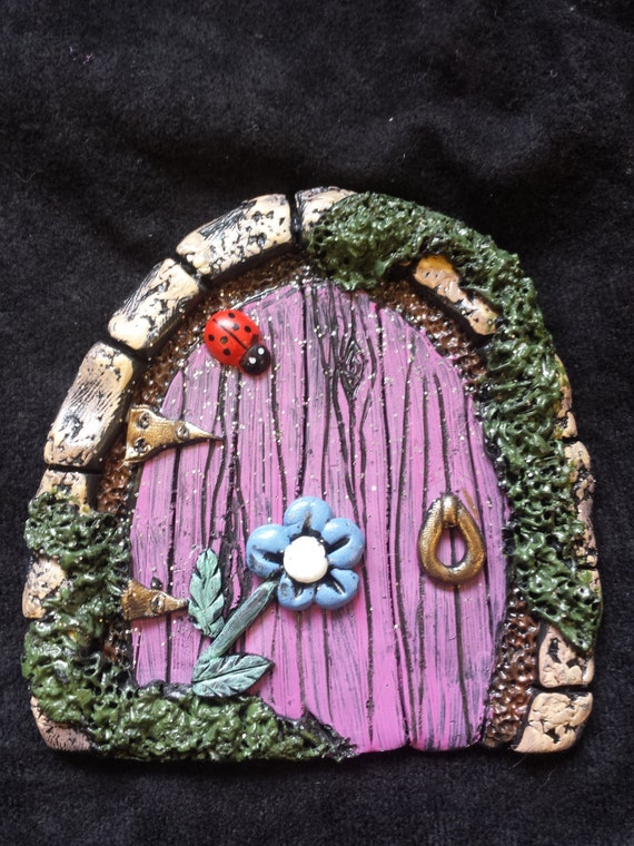 Faerie fairy door pink door with blue flower and a ladybug for The faerie door