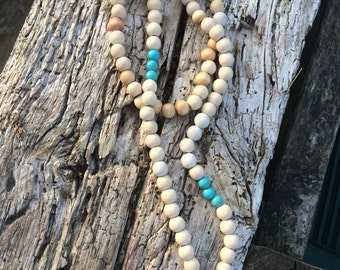 Saltire cream and turquoise beads