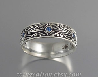 The COUNT silver and Blue Sapphires wedding band