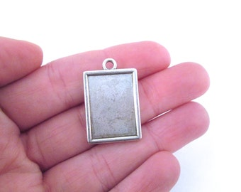 Silver plated rectangle settings (holds a 15x21mm cab), pick your amount