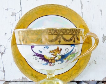Noritake, made in Japan, luster ware cup and saucer , dragon and fruit