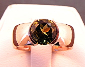 AAA Green Tourmaline   7.00mm  1.50 Carats   in 14K rose gold ring. 1039