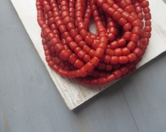 small red seed beads , opaque tomato red glass beads , irregular barrel tube spacer , New Indo-pacific 4 to 6 mm / 22 inches strand 5bgl3-5