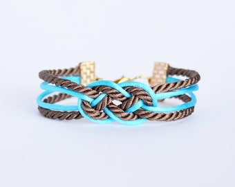 Brown and aqua blue double infinity knot nautical rope bracelet with gold anchor charm