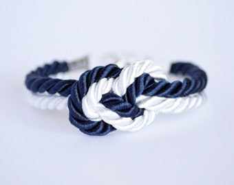 Navy blue and white infinity knot nautical rope bracelet with silver anchor charm