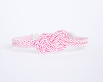 Pink infinity knot nautical rope bracelet with silver anchor charm