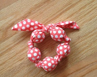Coral and White Polka Dot Teether