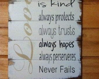 "Love is patient, kind, always protects, always trusts 1 Corinthians Bible quote 13""w x17 1/2"" hand-painted wood sign"
