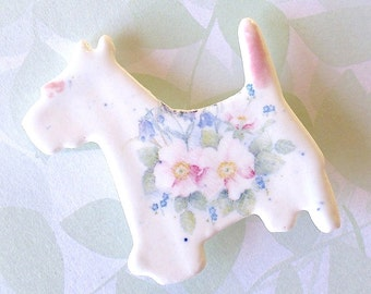 Porcelain Dog Brooch. Pastel Wildflowers. Westie. Scottie. Ceramic. Pale Pink. Sky Blue. Green. Yellow. Roses. Forget-Me-Nots. Whimsical