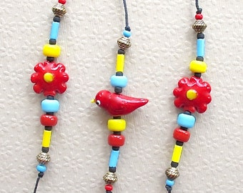 Beaded Wind Chime:  Garden Chime with Lampwork Glass Bird & Flower Beads. Cardinal. Daisy. Red. Aqua. Yellow. Black. 1960s Retro. Brass Bell