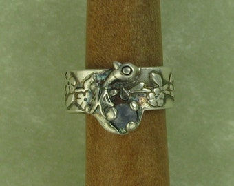 Fairy dragon fine silver ear cuff with a light blue sapphire DTPD PMC