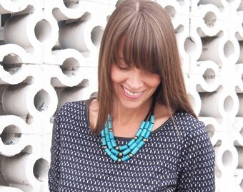 wooden dark turquoise (scuba blue) and brass necklace on black organic cotton jersey