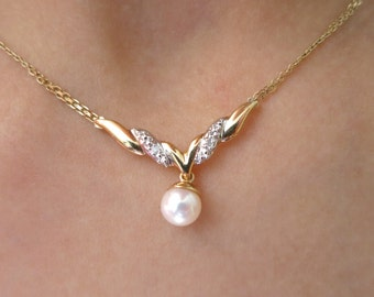 14K Yellow gold diamond pearl pendent.