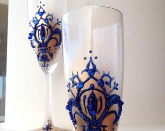 Gold and dark blue wedding toasting flutes with fleur de lis decoration, Wedding glasses, wedding reception, bridal shower gift