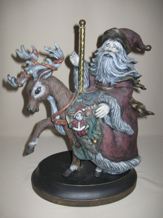 Figurine ceramic carousel santa riding his reindeer with