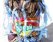 Yarn with tassels. Yarn Brasilia light blue tassels on  brown. Unique ladder yarn with ribbon pendants tassels. Blue on beige