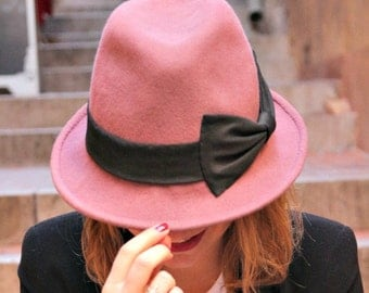 Dusky pink womans fedora hat. Designer French millinery hat. Fashionable womans trilby hat. Pink hat with large black bow.