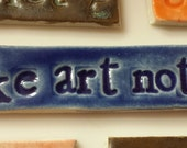 Make Art Not War stoneware focal tile for mosaic or jewelry