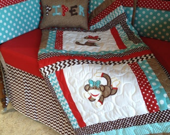 Chevron sock monkey crib set with six piece bumper, pleated bedskirt, fitted sheet, quilt, and personalized pillow