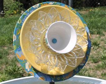 Yellow, Green and Blue Pottery and Glass Garden Flowers / Garden Art