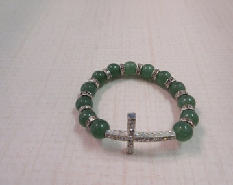 Green glass beaded bracelet with silver sideway cross.