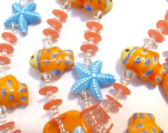 Sunny Ocean/Beach Fun Necklace with Cute Orange Ceramic Fish and Aqua Starfish #orangenecklace #aquanecklace #beachaccessories #etsyhandmade