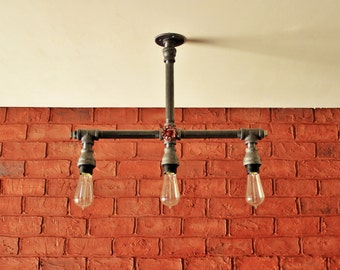 Pipe lights steampunk industrial pipe wall art vintage for Iron pipe ceiling light