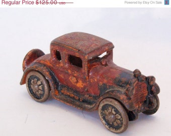 Antique Cast Iron Toy A.C. Williams, Arcade, Hubley Car with tin wheels