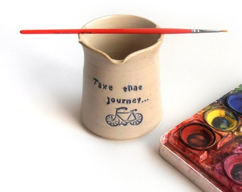 Paintbrush cup for holding your water and brush in an artful manner